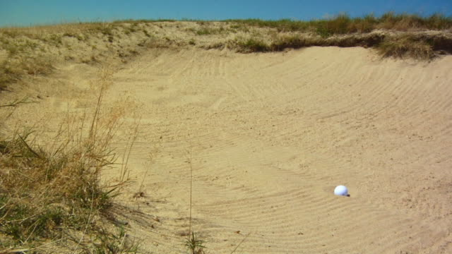 ms, golf ball landing in sand trap, north truro, massachusetts, usa - golf ball stock videos & royalty-free footage