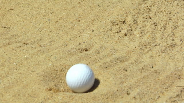 CU, Golf ball landing in sand trap, North Truro, Massachusetts, USA