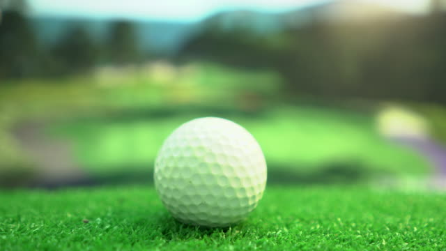 Golf ball moving to beautiful golf course, Slow motion.