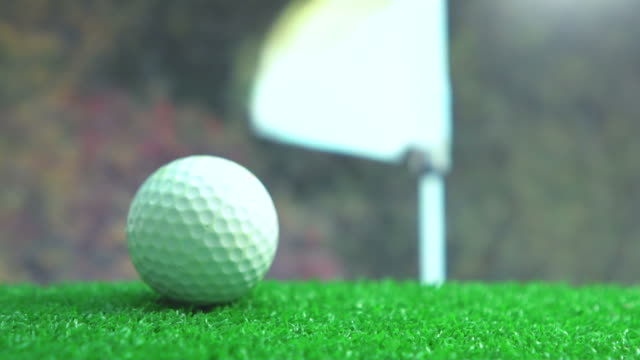 Golf ball moving to putting green