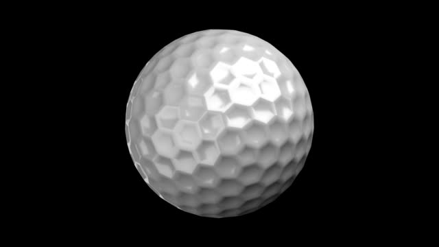 golf ball on black bg - golf ball stock videos and b-roll footage