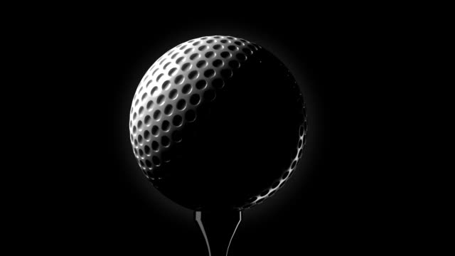 golf ball on tee closeup - golf ball stock videos and b-roll footage