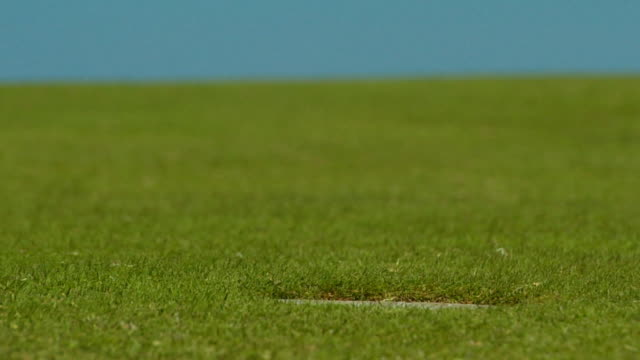 CU, SELECTIVE FOCUS, Golf ball passing hole, North Truro, Massachusetts, USA