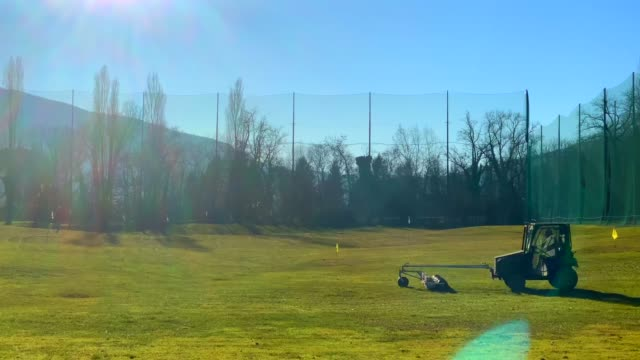 golf ball retrieval machine at driving range in switzerland. - drive ball sports stock videos & royalty-free footage