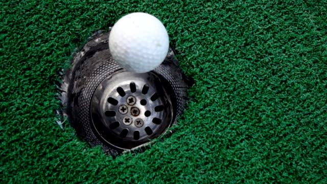 golf ball rolling into the hole on putting green,slow motion - hole stock videos & royalty-free footage