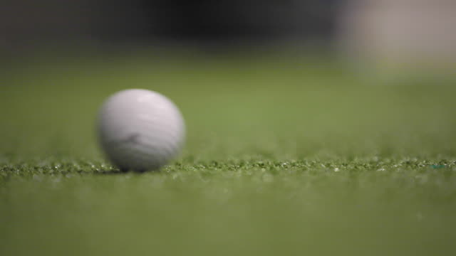 a golf ball rolling on the green - golf ball stock videos & royalty-free footage