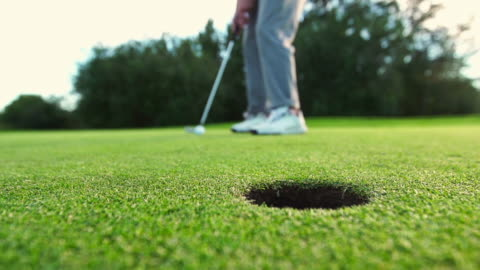 golf ball rolls into cup - putting stock videos & royalty-free footage