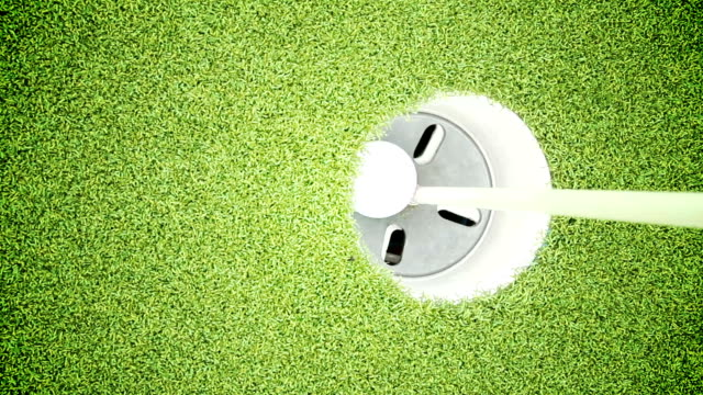 golf ball rolls into hole - golf ball stock videos & royalty-free footage
