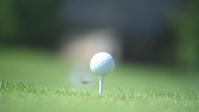 golf ball set to strike