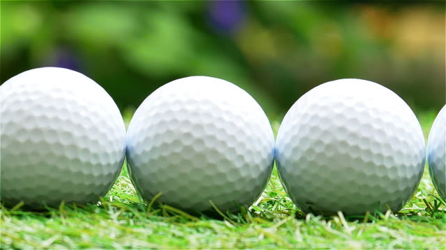 golf ball with bokeh on green background. - golf club stock videos & royalty-free footage