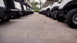 Golf cars or golf carts in a row outdoors on a sunny spring day.Sports Cinemagraphs