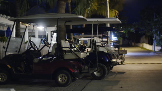 golf carts in the night - golf cart stock videos & royalty-free footage