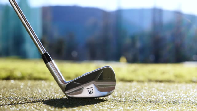 golf club miura mc501 and golf swing on the golf ball with sunlight in switzerland - low section stock videos & royalty-free footage