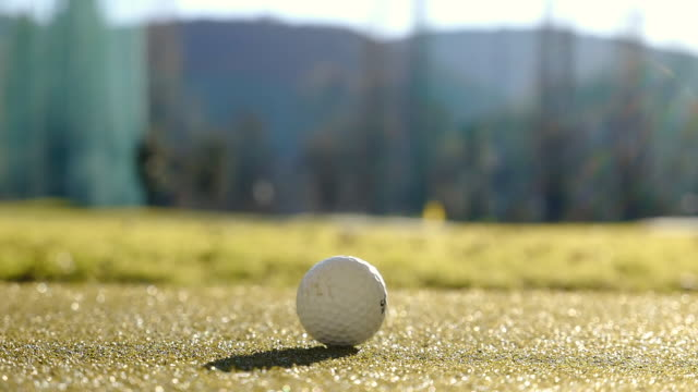 golf club miura mc-501 and golf swing on the golf ball with sunlight in switzerland. - golf ball stock videos & royalty-free footage
