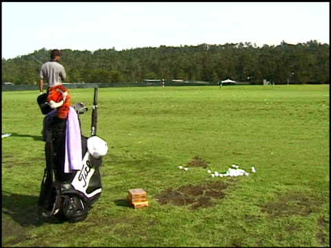 cu golf clubs with stuffed tiger over clubs / tiger woods practicing golf swings before the att pebble beach national proam tournament tiger woods... - pga event stock videos and b-roll footage
