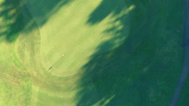 golf course and flag aerial view - green golf course stock videos and b-roll footage