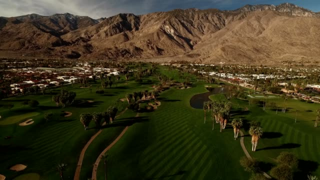 golf course and mountains in palm springs - palm springs california stock videos & royalty-free footage