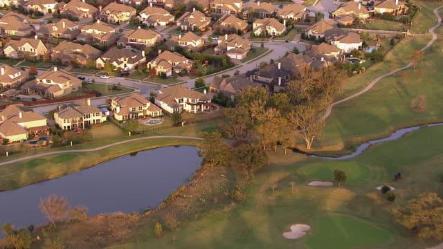 A golf course borders large houses in a suburban neighborhood near Dallas, Texas.