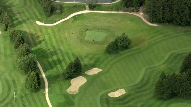 vídeos de stock, filmes e b-roll de aerial zo golf course, crans sur sierre, valais, switzerland - bolsa de golfe
