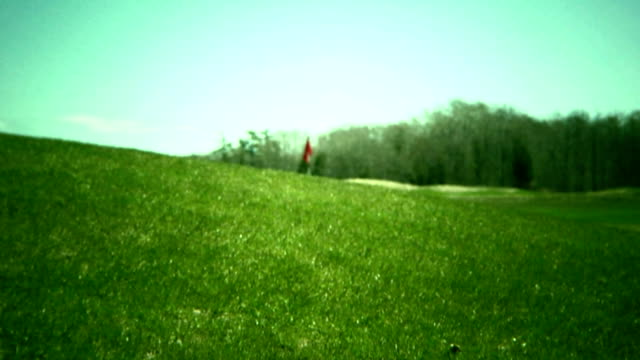 golf course dolly - golf flag stock videos and b-roll footage