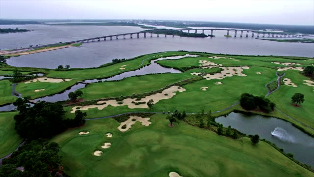 golf course in louisiana with bridge in the background at lake charles - louisiana stock videos & royalty-free footage