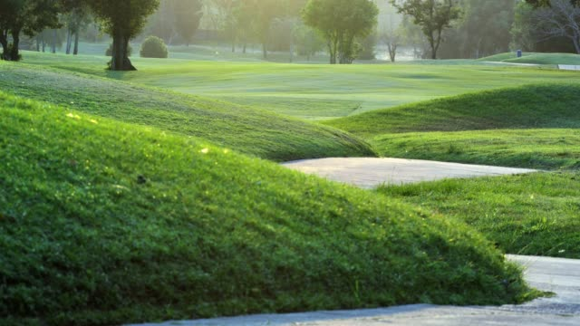 golf course in the countryside,green golf field, golfing holidays.sports cinemagraphs - golf cart stock videos and b-roll footage
