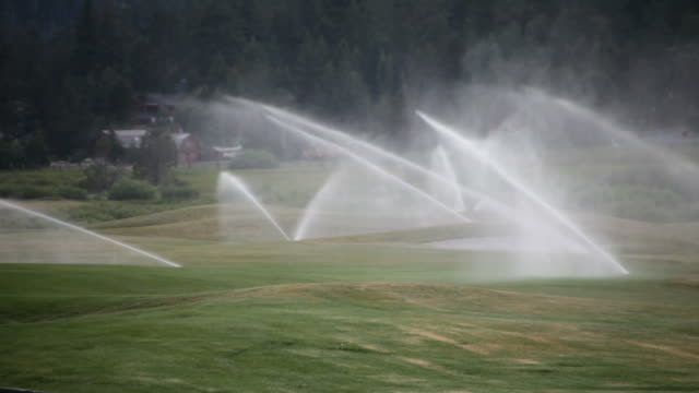 golf course sprinkler system - irrigation equipment stock videos & royalty-free footage