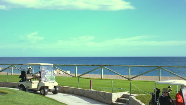 golf course with beach - golf cart stock videos and b-roll footage