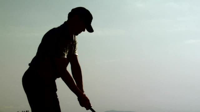 golf: drive - golf swing silhouette stock videos & royalty-free footage