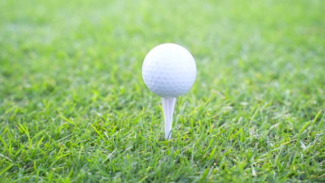 golf - golf ball pinning on ground - golf ball stock videos & royalty-free footage