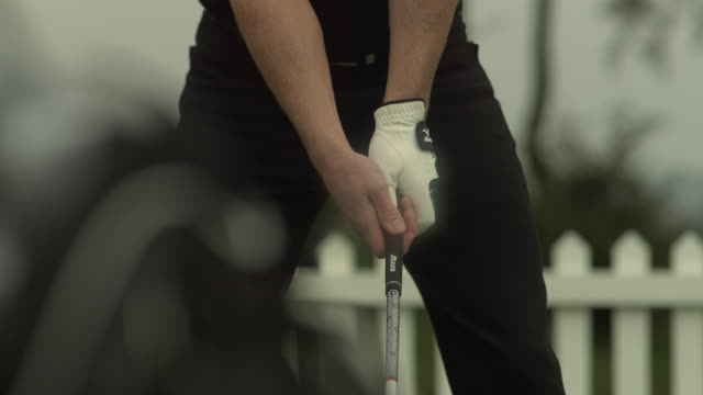golf grip and swing torso, mid shot - golf shot stock videos & royalty-free footage