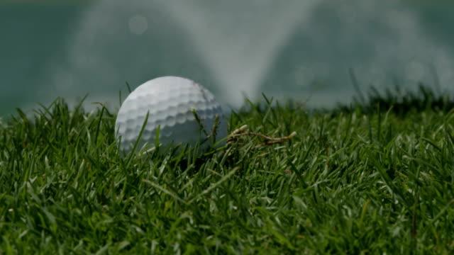 golf hit, slow motion ecu - golf club stock videos & royalty-free footage