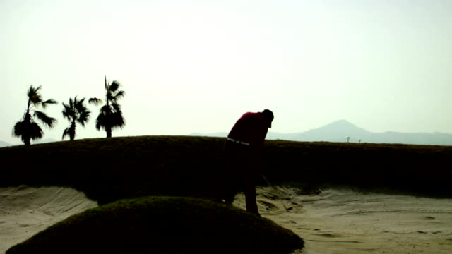 golf: out of the bunker - sand pit stock videos and b-roll footage