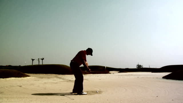golf: out of the bunker - golf swing motion stock videos & royalty-free footage