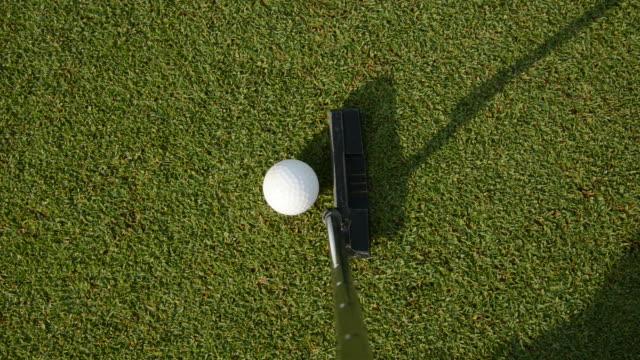 ゴルフの練習します。 - パットする点の映像素材/bロール