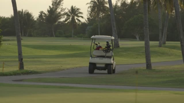 vídeos de stock, filmes e b-roll de a golf resort and golfers near havana cuba on january 27th 2015 shots exterior wide shot of a large sign of a golfer with the words varadero gulf... - golf cart