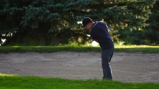 golf sand trap - golf swing stock videos & royalty-free footage