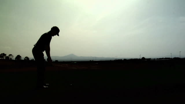 golf: silhouette tee shot - golfer stock videos and b-roll footage