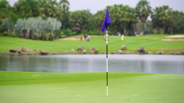 golf sport concept flag - golf swing stock videos & royalty-free footage