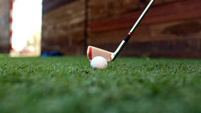 golf stick and ball on green grass - golf stock videos & royalty-free footage