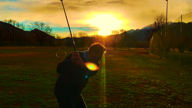 golf swing in sunset - golf course stock videos & royalty-free footage
