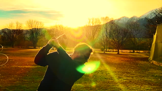 golf swing in sunset - golf swing on white stock videos & royalty-free footage