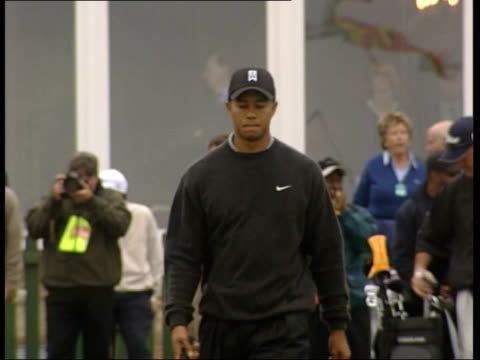 tiger woods cf tape no longer available scotland edinburgh muirfield golfer tiger woods along as arriving at course and signs autographs for fans... - driving range stock videos & royalty-free footage