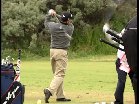 tiger woods itn scotland edinburgh muirfield ext golfer tiger woods along on course during warm up session woods hitting shot from bunker golfers... - tiger woods stock videos & royalty-free footage
