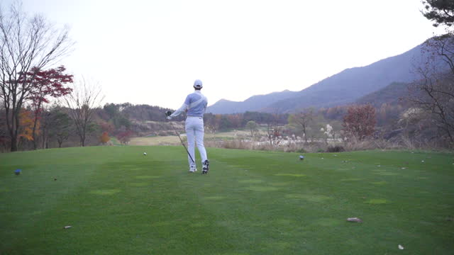 golf - young man swinging with driver - swinging stock videos & royalty-free footage