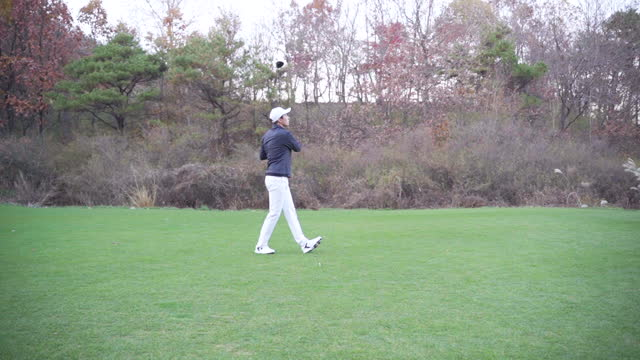 golf - young man swinging with driver - cap stock videos & royalty-free footage