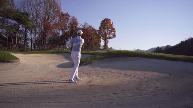 golf - young man swinging with iron at bunker - golf swing stock videos & royalty-free footage