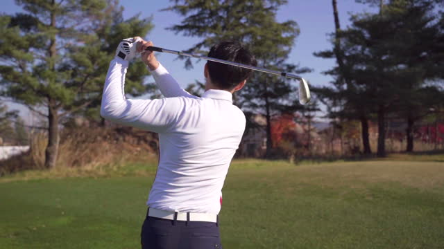 golf - young man swinging with iron - dolly shot stock videos & royalty-free footage