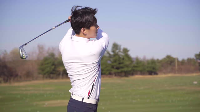 golf - young man swinging with iron - golf swing stock videos & royalty-free footage