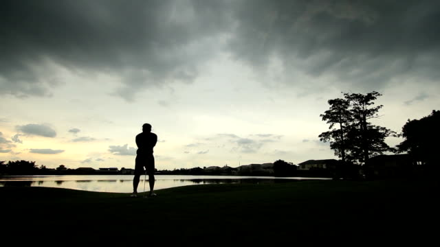 golfer at sunset - golf course stock videos & royalty-free footage